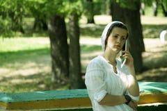 Девушка с устройством Стоковое Изображение RF