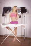 Девушка с утюгом Стоковое Изображение RF
