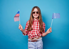 Девушка с 2 флагами Стоковая Фотография