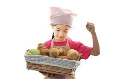 Девушка с хлебом стоковое фото rf