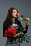 Девушка с цветками стоковые изображения rf