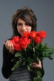 Девушка с цветками стоковые фото