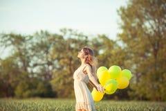 Девушка с baloons Стоковые Фотографии RF