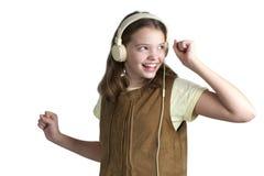 Девушка танцев с наушниками музыки на ее голове Стоковое фото RF