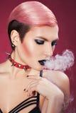 Девушка дует дым. стоковые изображения