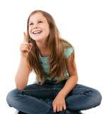 Девушка указывая вверх Стоковая Фотография