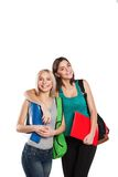 Девушка 2 усмехаясь студентов с сумками школы дальше Стоковое Изображение RF