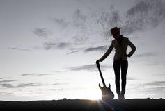 Девушка утеса с гитарой Мультимедиа Стоковая Фотография RF
