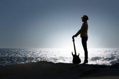 Девушка утеса с гитарой Мультимедиа Стоковые Изображения RF