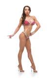 Девушка фитнеса бикини в красном купальнике Стоковые Изображения RF