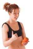 Девушка фитнеса с papper, большим пальцем руки Стоковые Фото