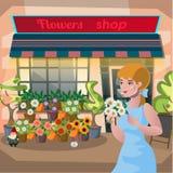 Девушка флориста держа бак цветков в цветочном магазине Стоковое Изображение RF