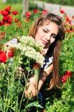 девушка цветков пука одичалая Стоковые Изображения