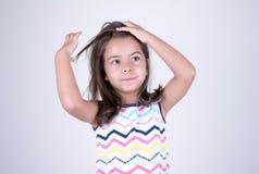 Девушка шевеля ее волосы Стоковое Изображение