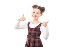 Девушка школы давая большие пальцы руки вверх Стоковое Изображение RF