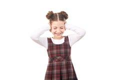 Девушка школы покрывая ее уши Стоковые Изображения RF