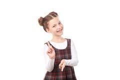 Девушка школы указывая на вас Стоковые Изображения