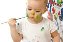 девушка щеки ее меньшяя краска Стоковая Фотография