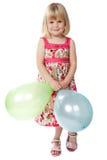 девушка 4 воздушных шаров держа старый год Стоковые Изображения