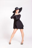 Девушка pin-вверх с большой черной шляпой Стоковые Фото