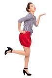 Девушка pin-вверх дуя поцелуй Стоковая Фотография