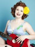 Девушка Pinup гитары Стоковое Изображение