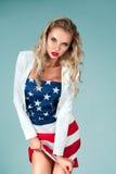 Девушка Pinup с американским флагом Стоковые Изображения