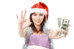 Девушка Santa Claus предлагает деньги Стоковое Изображение