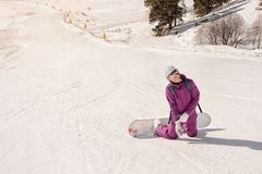 Девушка snowboarder Beginner Стоковое Изображение