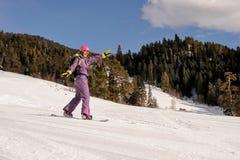 Девушка snowboarder Beginner Стоковое Изображение RF