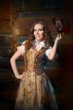 Девушка Steampunk с стеклами верхней шляпы и авиатора стоковые изображения