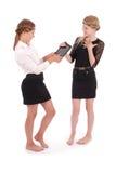 Девушки дают ПК таблетки одина другого Стоковые Фотографии RF