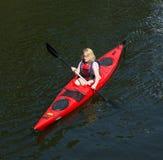 Девушки в каное Стоковые Фотографии RF