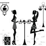Девушки в кафе после ходить по магазинам Стоковое Изображение RF