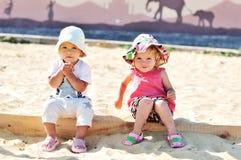 Девушки в песке Стоковые Фото