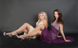 Девушки в платьях вечера Стоковые Изображения