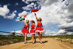 Девушки в поле Стоковые Изображения RF