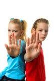 девушки делая знак остановить 2 Стоковые Фото
