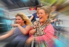 Девушки езды ярмарки Стоковое Изображение