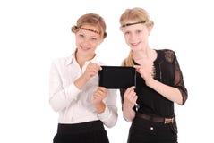 Девушки держа ПК таблетки Стоковая Фотография RF