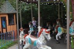 Девушки едут на carousel с лошадями 18692 Стоковое фото RF