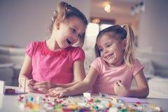 Девушки играя дома Стоковые Изображения