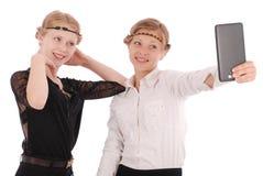 Девушки извлекают ПК таблетки собственной личности Стоковая Фотография