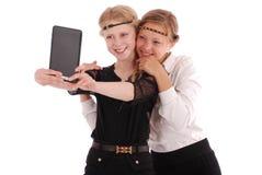 Девушки извлекают ПК таблетки собственной личности Стоковые Изображения RF