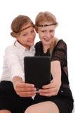 Девушки извлекают ПК таблетки собственной личности Стоковое фото RF