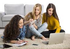 Девушки изучая дома Стоковая Фотография RF