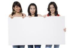 Девушки и знак Стоковое фото RF