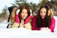 Девушки на снеге Стоковое Изображение RF