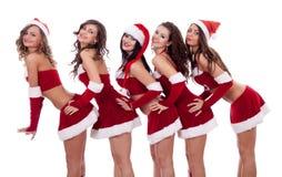 девушки представляя santa Стоковая Фотография RF