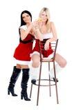 девушки рождества сидя th табуретки Стоковая Фотография RF